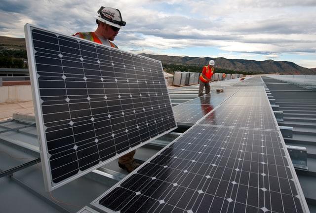 Men putting solar panels for renewable Australian solar shade.