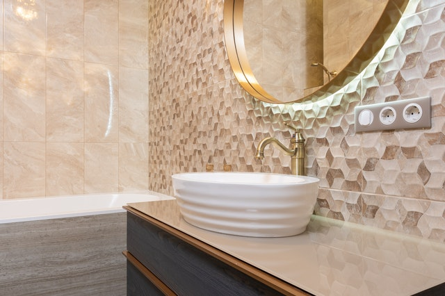 A bathroom in a home with tiles laid.