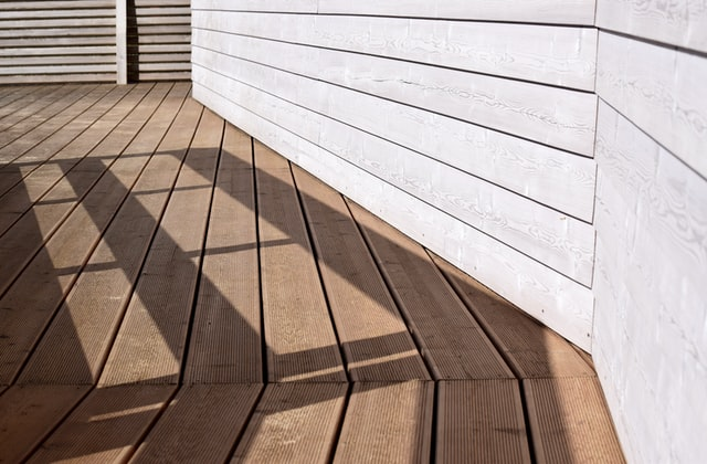 A home with a wooden deck.