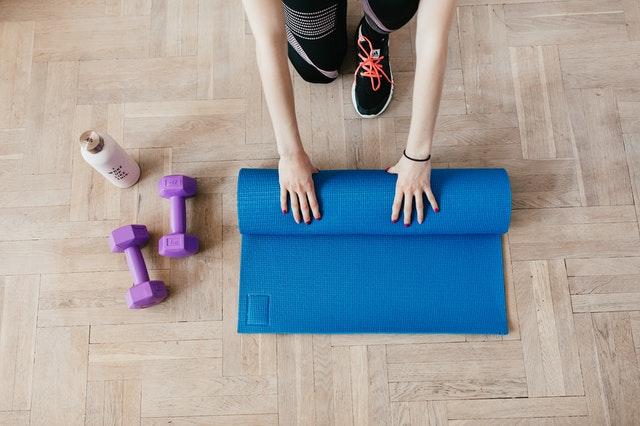 Woman setting up home gym