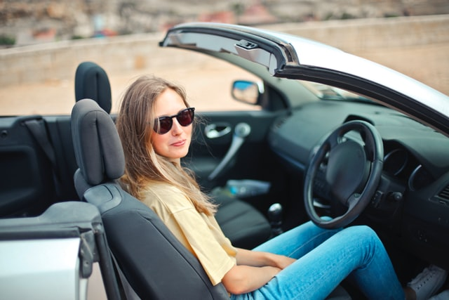 A woman in a car with car accessories from the industry that is building momentum.